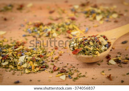 mixture of herbs in the wooden desk - stock photo