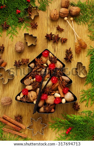 Mixture of nuts and spices in the form of a Christmas tree, Christmas. - stock photo