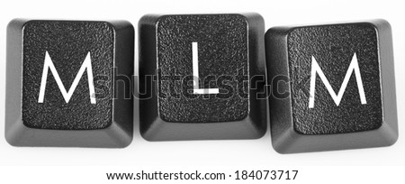 MLM (Multi Level Marketing) button on keyboard close-up - stock photo