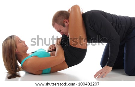 MMA female fighter taking an opponent by surprise with a triangle choke knockout - stock photo