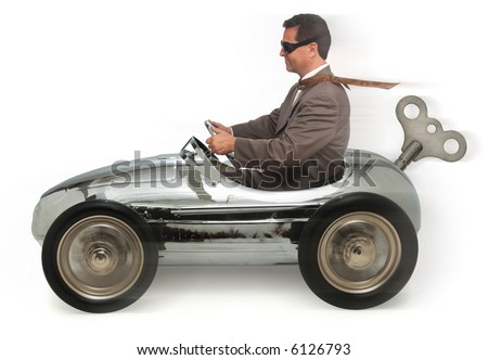 Mn in a wind-up/pedal car on white background - stock photo