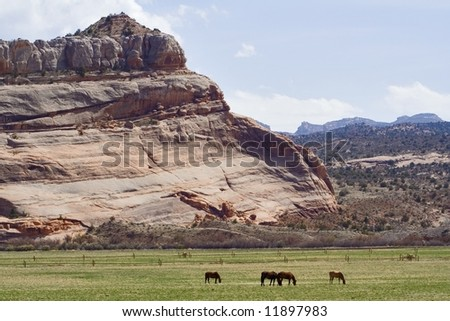Moab area mountains and spires with horses in Utah USA - stock photo