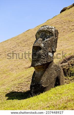Moai in Rapa Nui National Park on the slopes of Rano Raruku volcano on Easter Island, Chile. - stock photo