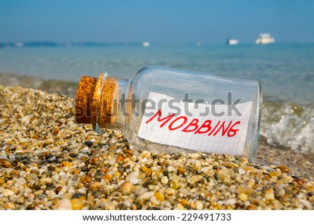 """Mobbing concept. Bottle with a message """"mobbing"""".  - stock photo"""