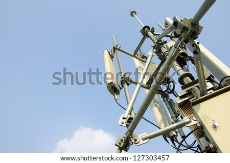 mobile antenna tower and blue sky. - stock photo