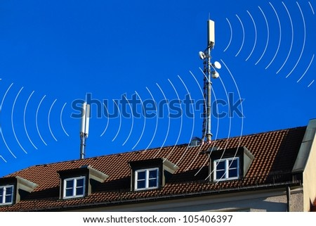 Mobile antennas with radiation - stock photo