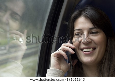 mobile communication on a train - stock photo