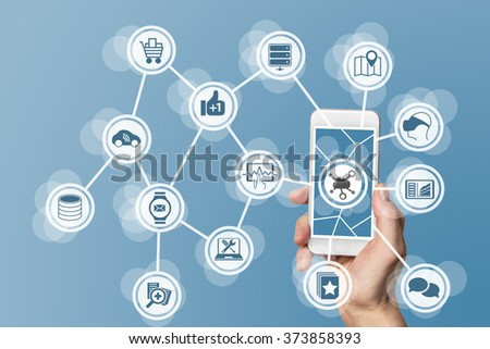 Mobile computing in the cloud with hand holding modern smart phone with touch screen - stock photo