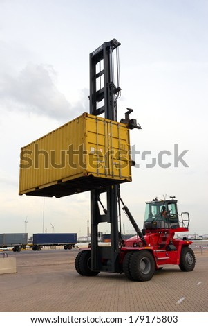 Mobile container handler  in action at a container terminal - stock photo