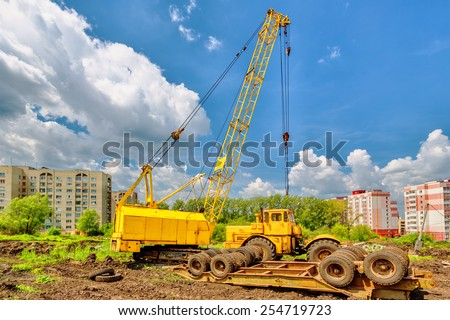 Mobile crane on a background of blue sky - stock photo