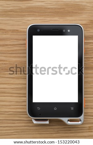 Mobile device with blank screen on a wooden surface - stock photo