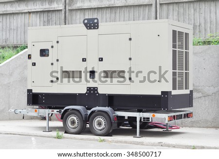 Mobile Diesel Generator on the Office Building Wall as a Background - stock photo