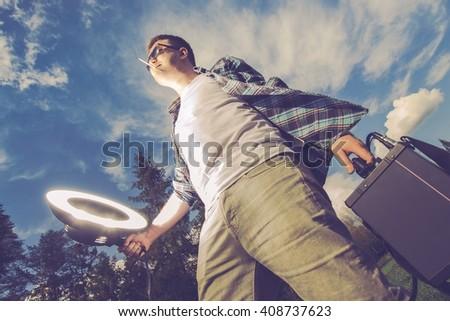 Mobile Flashlight Strobelight Photography Funny Concept. Young Men Enjoying Storbe Light White Caring and Using Flashlight on Himself. Mobile Flash Lighting Men - stock photo