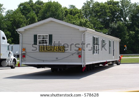 Mobile home stops in a rest area - stock photo
