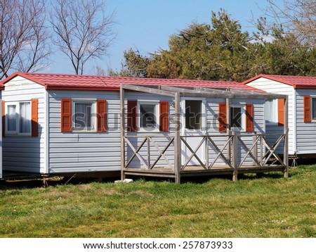 mobile home with veranda in campsite - stock photo