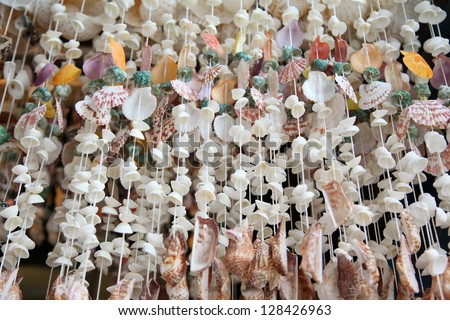 Mobile made from various shells. - stock photo