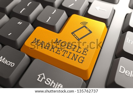 Mobile Marketing Concept. Orange Button on Computer Keyboard. 3D Render. - stock photo