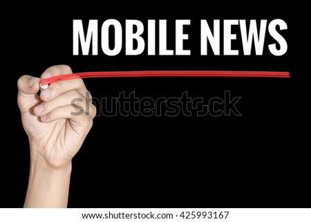 Mobile News word writing by men hand holding red highlighter pen on dark background - stock photo