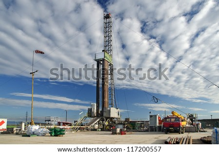 Mobile oil drilling rig during prospection - stock photo