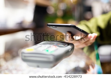 Mobile payment in optical shop with NFC - stock photo