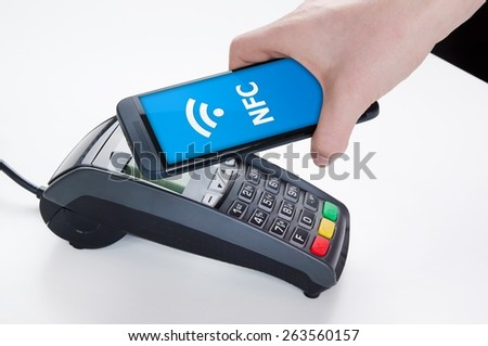 Mobile payment with NFC near field communication technology - stock photo