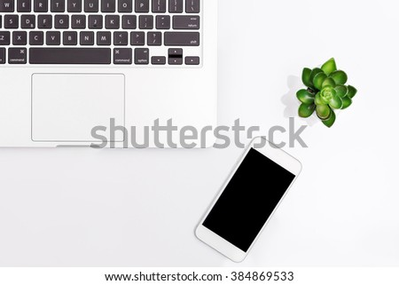 mobile phone and laptop isolated on a white background - stock photo
