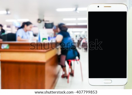 mobile phone, blur image inside hospital as background. - stock photo