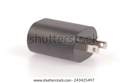 Mobile phone charger isolated on a white background. - stock photo