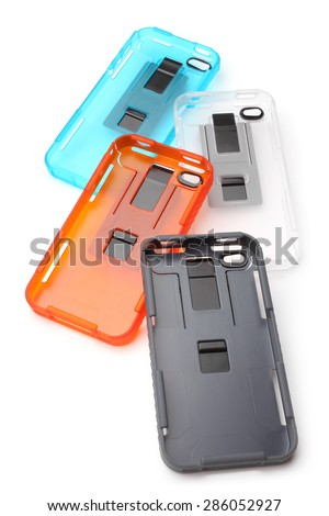 Mobile phone covers on white background - stock photo