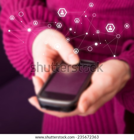 Mobile phone in female hands with added graphic connection icon - stock photo
