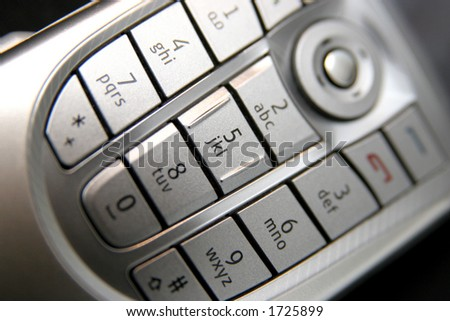 mobile phone keypad in closeup - stock photo