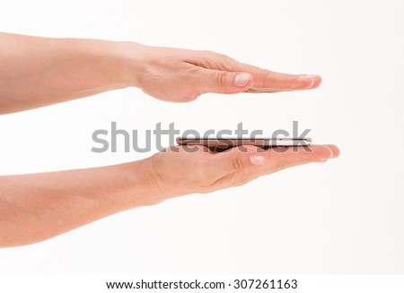 Mobile phone laid on man's palm, another hand right above it. Thin mobile phone is new modern concept of today's digital world. - stock photo
