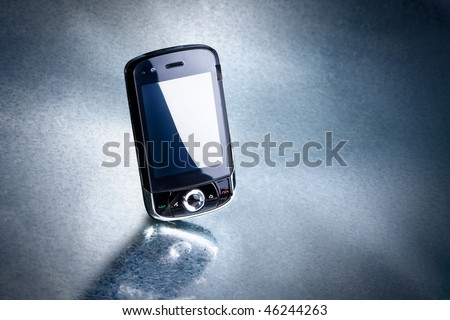 mobile phone on silver background. Look for more in MY PORTFOLIO - stock photo