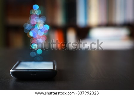 Mobile phone on the table against the background of written books. Shallow depth of field. - stock photo