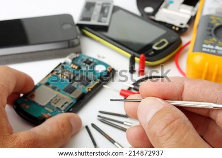 Mobile phone repair - stock photo
