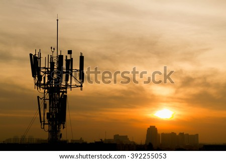 Mobile phone Telecommunication Radio antenna Tower with sunset sky, silhouette - stock photo