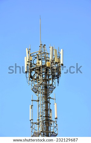Mobile Phone Tower Against Blue Sky - stock photo