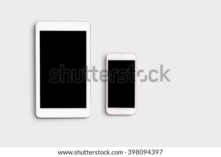 Mobile phone with blank screen mockup on white table background - stock photo