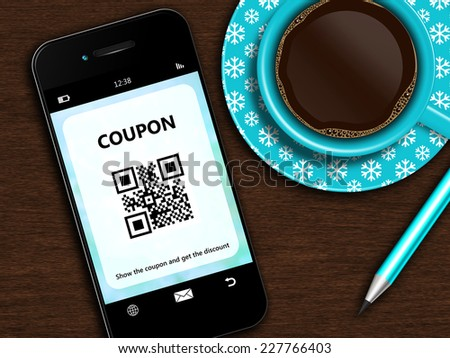 mobile phone with christmas coupon, cup of coffee and pencil lying on wooden desk - stock photo