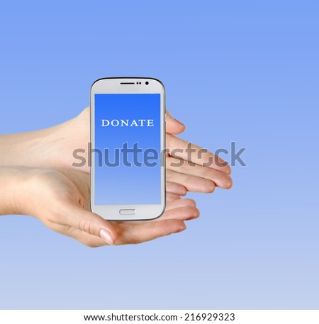 "Mobile phone with ""donate"" on its screen - stock photo"