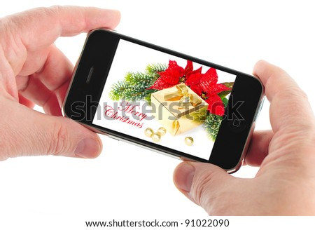 mobile phone with message merry christmas - stock photo