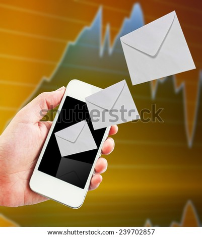 Mobile phone with new message received with stock exchange background. - stock photo