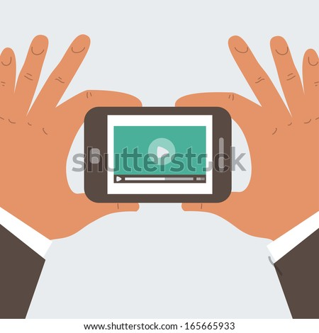 Mobile phone with video player on the screen in the human hands - stock photo