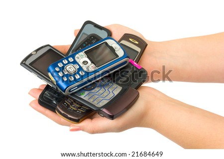 Mobile phones in woman hands isolated on white background - stock photo