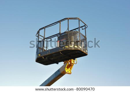 Mobile platform elevated towards a blue sky - stock photo