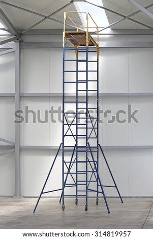 Mobile Scaffold Tower Platform in Distribution Warehouse - stock photo