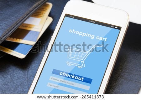 mobile shopping concept  -  virtual shop on phone screen with credit cards  - stock photo