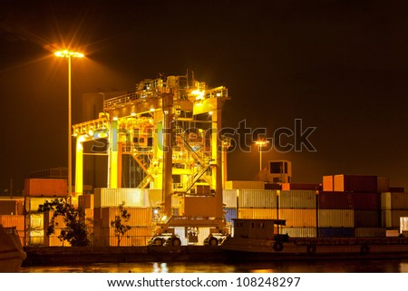 Mobility Crane car in commercial container cargo port for shipping - stock photo