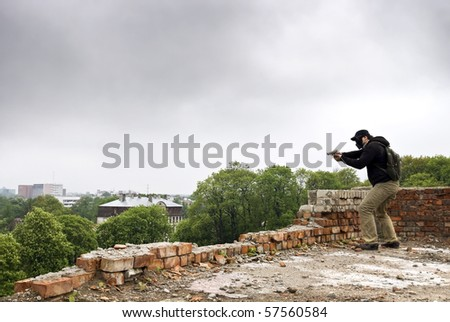 mobster shooting from the roof - stock photo