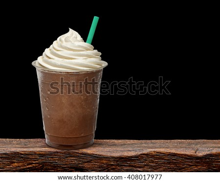 Mocha frappuccino in takeaway cup on wooden table - stock photo